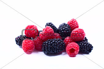 Blackberries and raspberries on a white background