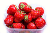 Strawberries in a container for sale