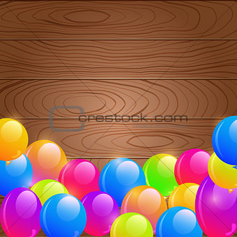 Bright Birthday Balloons on Wooden Background