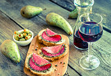 Sandwiches with italian salami and glass of wine