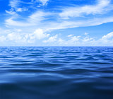 sea or ocean water surface with blue sky and clouds
