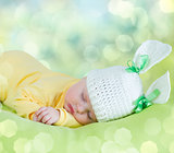 sleeping baby closeup portrait in hare or rabbit hat