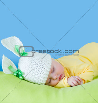 sleeping baby closeup portrait in hare or rabbit hat with expand
