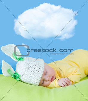 sleeping baby closeup portrait in hare or rabbit hat with dream