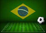Soccer or football field with ball and flag of Brazil