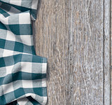 picnic cloth over old wooden table grunge background
