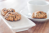 Coffee cup and mixed nut cookies