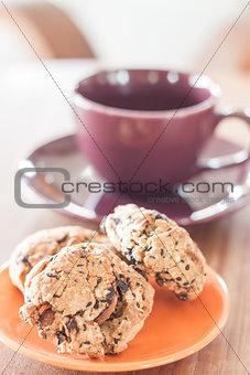Closeup cereal cookies on orange plate