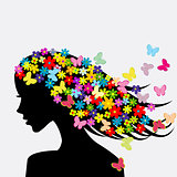 Beautiful woman profile silhouettes with flowers and butterflies