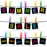 Summer sale concept with photo frames hanging on clothespins