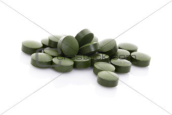 Green pills isolated on white background.