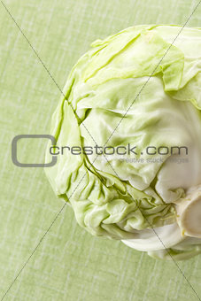 Green cabbage isolated on green.