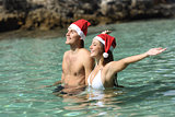 Couple bathing on the beach on christmas holidays
