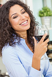 Hispanic Woman Smiling Drinking Red Wine
