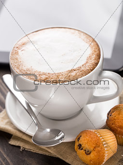 Cappuccino coffee with muffins