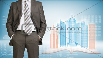 Businessman and wire-frame buildings on open book