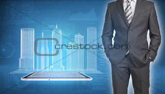 Businessman and wire-frame buildings on screen tablet pc