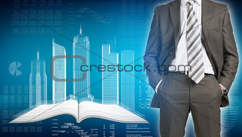 Businessman and wire-frame buildings on open empty book