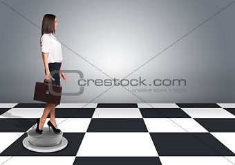 Beautiful businesswoman walking and holding briefcase