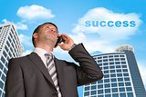 Businessman talking on the phone. Cloud with word success