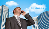 Businessman talking on the phone. Cloud with word business