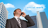 Businessman talking on the phone. Cloud with words social work