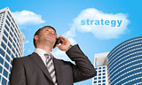 Businessman talking on the phone. Cloud with word strategy