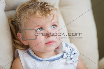 Adorable Blonde Haired and Blue Eyed Little Girl in Chair