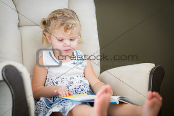 Blonde Haired Blue Eyed Little Girl Reading Her Book
