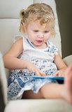 Blonde Haired Blue Eyed Little Girl Reading Her Book
