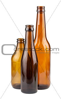 Three empty brown bottles