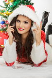 Smiling lady in Santa Claus outfit