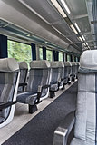 Passenger train interior with empty eats