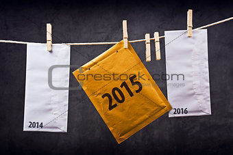 Three Envelopes with year numbers on clothes rope