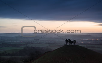 Beautiful sunrise dawn landscape of hills overlooking brightly l