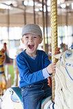 kid at the amusement park