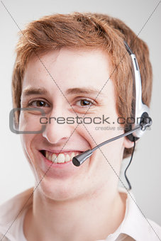 Call center red head smiling boy