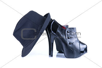 Black high heel female shoes with fedora hat