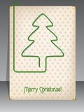 Christmas card with christmas tree shaped paper clip