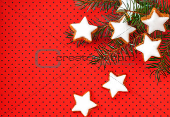 Cinnamon stars on red background