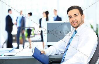 Portrait of smiling businessman working
