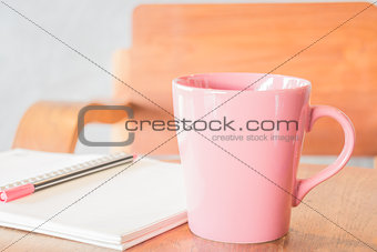 Freelance work table with notepaper and coffee