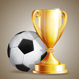 Gold cup with a football ball.