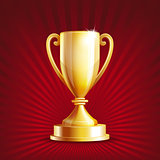 Golden trophy cup on red background.