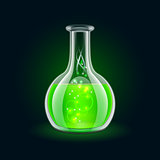 Transparent flask with magic green liquid on black background.