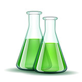 Chemical laboratory transparent flasks with green liquid.