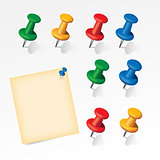 Colorful pins set with paper note