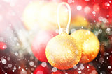 Christmas card with gold baubles and sparkles