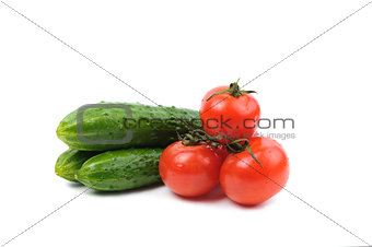 tomatoes and cucumbers vegetables isolated on a white background