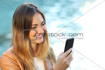 Casual woman using a smart phone